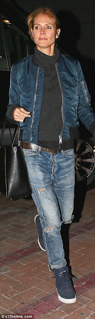 Her inner tomboy: Heidi Klum ditched the glamour on Saturday night as she stepped out in boyfriend jeans with her beau VitoSchnabel at Mr Chow in Beverly Hills. The star arrived at the Golden Globes in January in a gorgeous red gown