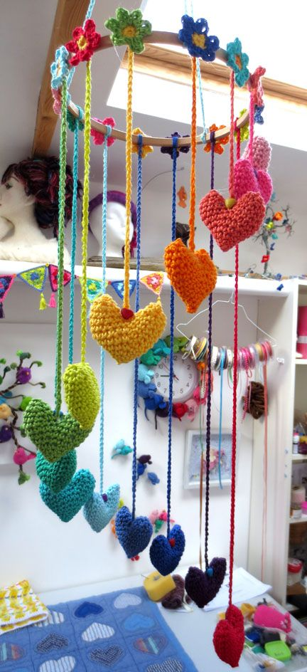 Hearts and Flowers Mobile in studio  https://www.etsy.com/listing/104936247/hearts-and-flowers-crochet-garland