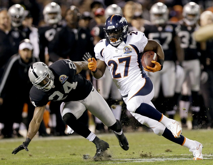 Broncos Raiders Football - Michael Huff, Knowshon Moreno  Denver Broncos running back Knowshon Moreno (27) carries the ball past Oakland Raiders cornerback Michael Huff (24) during the first quarter of an NFL football game in Oakland, Calif., Thursday, Dec. 6, 2012. (AP Photo/Marcio Jose Sanchez)
