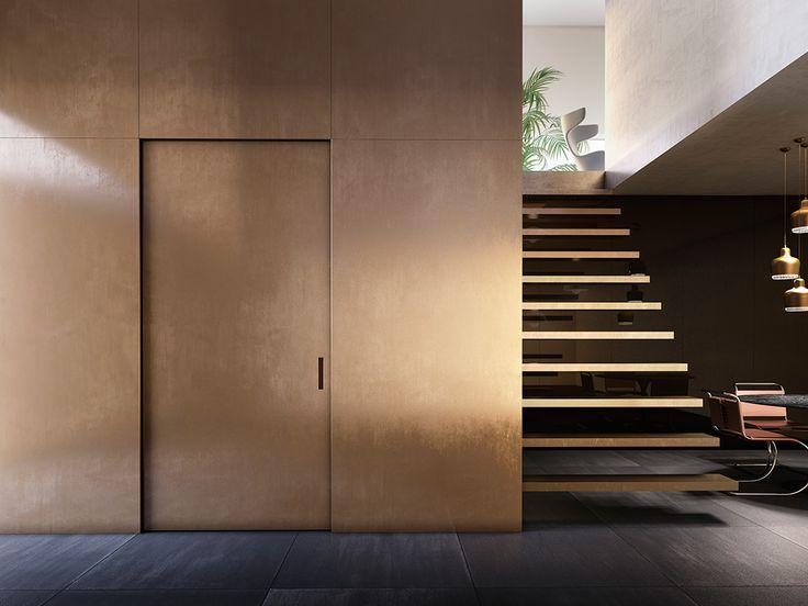 L'Invisibile Pocket door, Private house.  Surfaces made of metal, matt brass finishing as the wall.