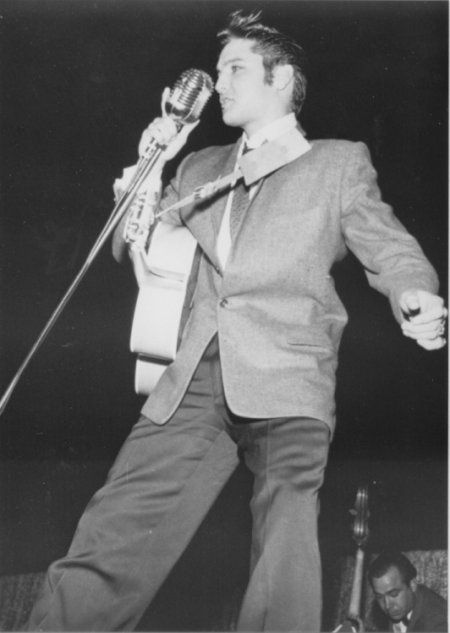 "Heart O' Texas Coliseum, Waco, TX - Oct. 12, 1956   |  Photo/Jimmie Willis ctsy Ger Rijff | ""Presley went through his regular ""routine"" of dancing all over the stage, pulling at his hair and having the appearance of being unable to control himself. One of Presley's most avid fans, Kay Wheeler, 17, of Dallas, who calls herself the president of the National Elvis Presley Fan Club, says she was ashamed of the turnout and called Waco ""the squarest town in America."" /The Waco News-Tribune"