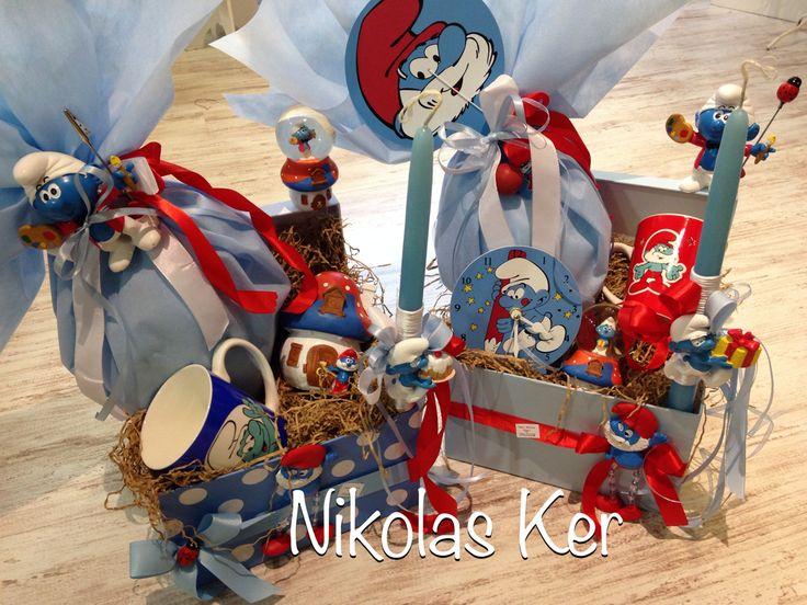 Πασχαλινά κουτιά μα στρουμφάκια! Περιέχουν σοκολατένιο αυγό & λαμπάδα. Κούπα, ρακέτα, ρολόι, νερόμπαλα διακοσμητική, stick για φωτογραφίες.  www.nikolas-ker.gr