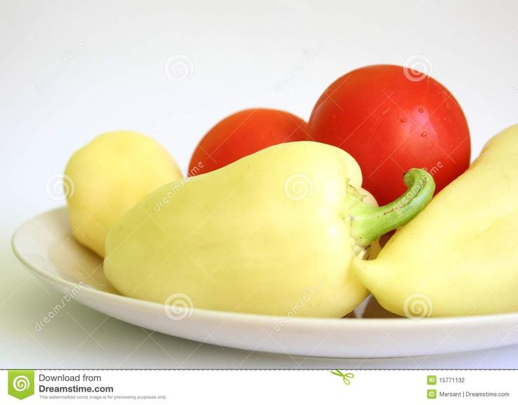 Yellow peppers and tomatoes on a plate