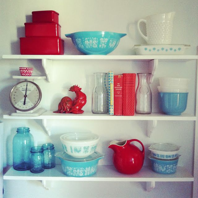 love the colors. red and aqua kitchen with eclectic collection of kitchen stuff.