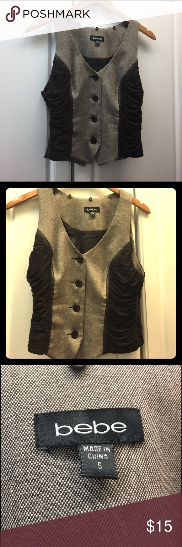 BEBE brown vest Worn 1 time now unfortunately it won't fit any more 😢 very cute in person would be a great addition to your wardrobe! If you have questions please ask bebe Tops