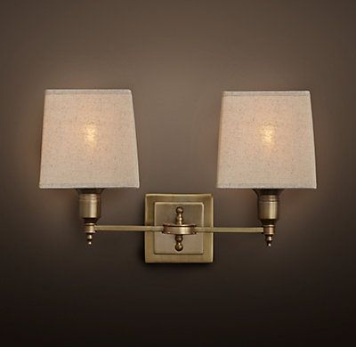 RH's Claridge Double Sconce With Linen Shade:Elegant hotels and other well-dressed venues illuminate their spaces with lighting based on traditional lamps. Our sconce reflects this sensibility, with all-brass construction and thoroughly classic design.