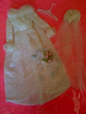 Vintage Barbie Wedding Dress: Dress is in the package, sewn into the cardboard with a stamp on the back of and A/319 in a circle.  Barbie hanger is early 1960's.  I also have 2 barbie