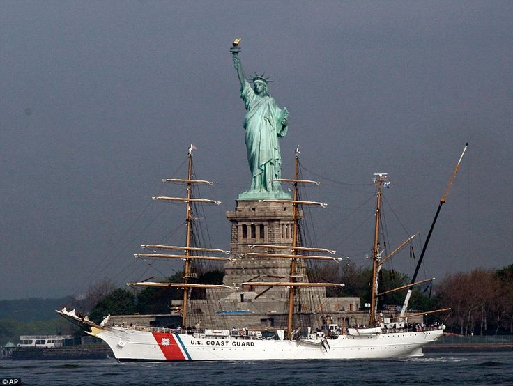 US Coast Guard Barque Eagle passes the Statue of Liberty at Fleet Week in NY