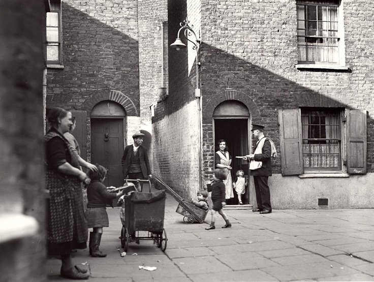 £2.50 - Greetings card - Postman delivering mail in Wapping in the East End of London, 1935. Available from http://www.postalheritage.org.uk/page/greetings-wapping