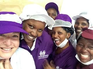 Happy workers at Ten Senses macadamia factory with show host, Lisa Chait