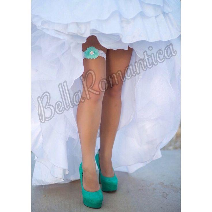 A personal favorite from my Etsy shop https://www.etsy.com/listing/121477916/aqua-wedding-sea-foam-wedding-garter-set