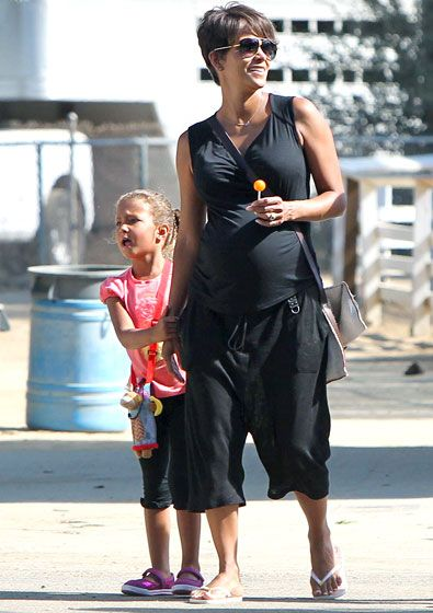Halle's Lolly Sucking on an orange lollipop, pregnant Halle Berry and daughter Nahla stepped out in L.A. Aug. 27.