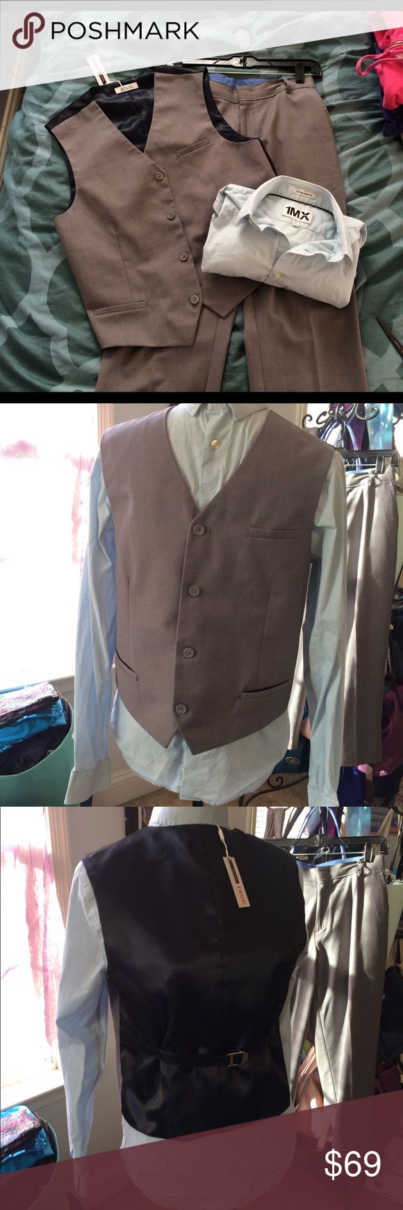 """Boys 3 piece suit with vest worn once! Boys 3 piece suit with vest worn once! Grey slacks, grey vest with shark tail blue back, and blue button up dress shirt. I will throw in a tie with the set! In perfect condition! Slacks are 24"""" inseam 34"""" overall length and 32"""" waist! Izod Matching Sets"""