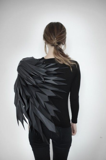 Mashallah Design: A three-step sequence of a bird spreading its wings is reconstructed and sculpted into T-Shirts. As the change in the wings' position is a function of time, each wing's plumage is reduced to polygonal form, modeled and rigged into successive arrangements to portray the spreading motion.