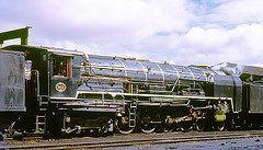R4377.  25NC 3413 at De Aar. 3rd September,1972. (Ron Fisher) Tags: sas sar narrowgauge schmalspurbahn 25nc southafricanrailways voieetroite capegauge 36gauge southafricansteam vision:outdoor=099 vision:sky=0842 vision:ocean=0756 vision:clouds=0538