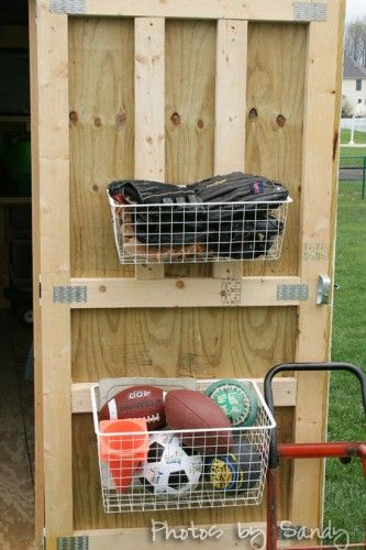Kris and I have big plans to organize our shed - it's a disaster!  We would like to take advantage all usable space and hang baskets from the door to organize the kids' toys/sports equipment.  Plus, it will be easy for them to access.