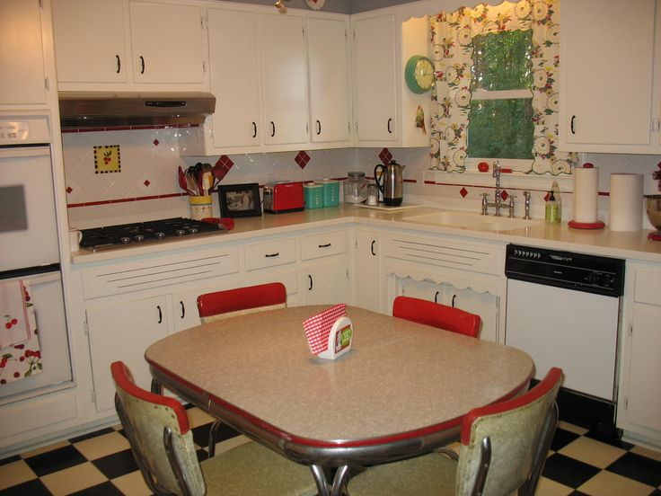 Oh, goodness.  This looks like the kitchen I grew up in, except we had a 1960's wood dining table :) My mom would keep the white cabinets clean too!