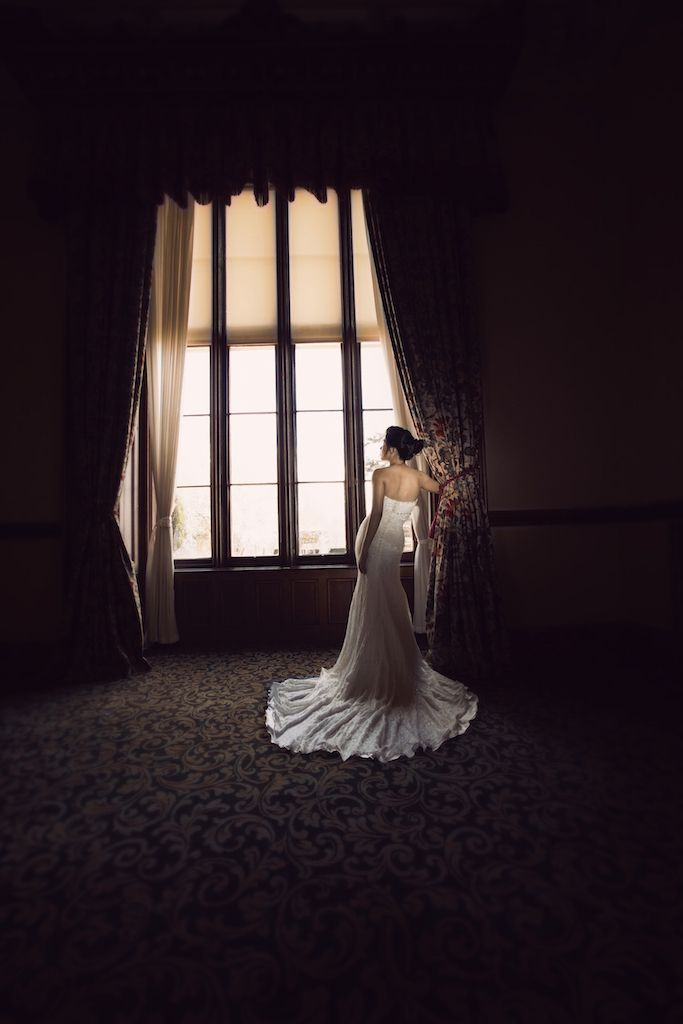 Beautiful Wedding Portrait At Matfen Hall Northumberland Dramatic Window Light Casting A Silhouette Showing