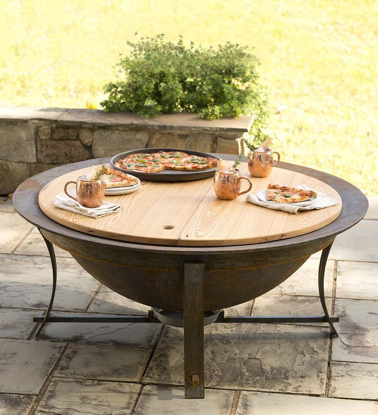 """Syrup Kettle Fire Pit with Stand Set – love this look! Patterned after the ubiquitous cast iron syrup kettles of 19th Century Georgia, the 48"""" diameter Syrup Kettle Fire Pit is made from durable, recycled metal that can be passed down from generation to generation."""
