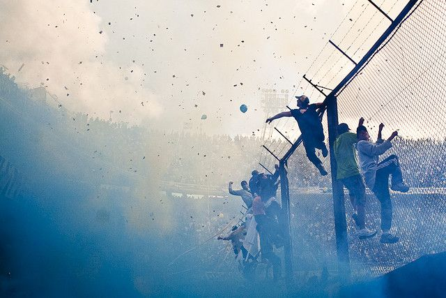 This is at a Bocca Juniors soccer game in Buenos Aires. It was an incredible atmosphere, this pic really captures it.  (photo taken by  http://www.flickr.com/people/alejokirchuk/)