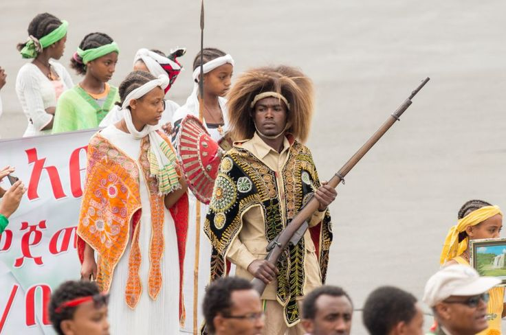 Arbegnoch Qen - Patriots' Day-Addis Ababa - May 5: Young men and women dressed in colourful traditional outfit march flag at the 74th anniversary of Patriots' Victory day commemorating the defeat of the invading Italians on May 5, 2015 in Addis Ababa, Ethiopia.