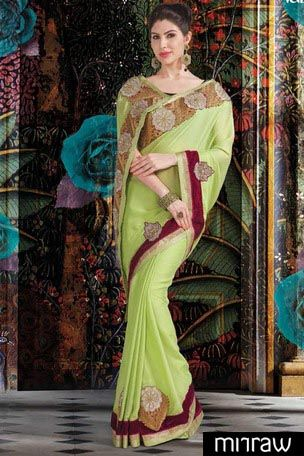New Pista green georgette foil printed saree in wine velvet blouse in golden border & pista green pallu along with gold & wine combo saree border to give you a chic look.
