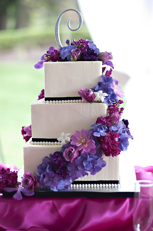 Elizhalee's Wedding Cake - Welcome! Beautiful, simple white square, stacked wedding cake with cascading purple flowers. www.hawaiianweddings.net #weddingcake #purplewedding #purpleflowers