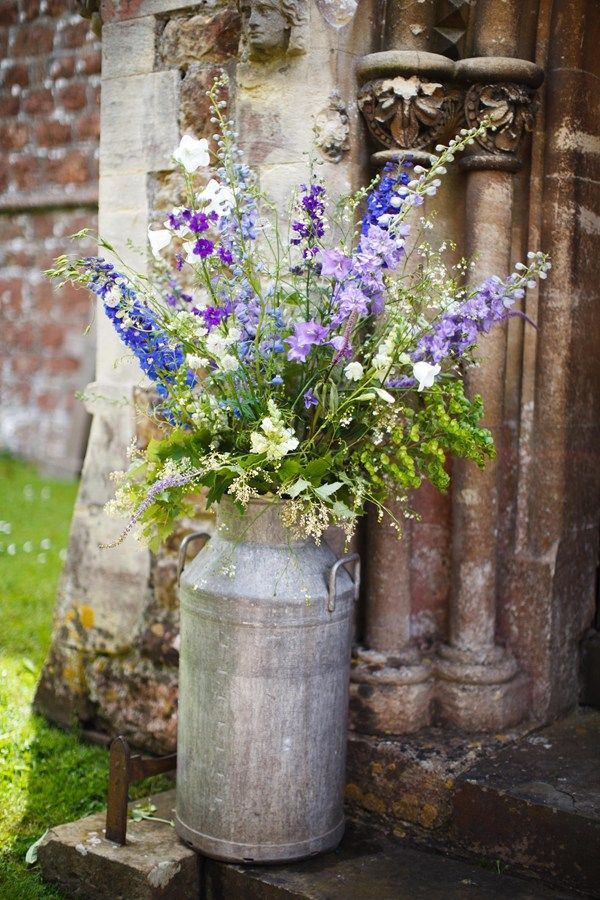 Wild country blooms including delphiniums, peonies, campanula, ammi, cornflowers, larkspur, honesty, stephanandra and seedheads.