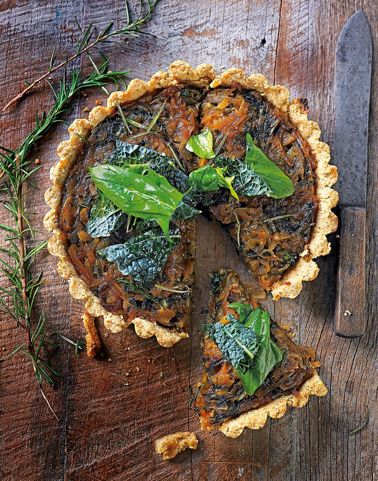 A vegetarian and gluten-free tart recipe made with a cashew cream, sweet onions, spinach and kale.