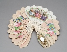Date Made  1900  Description  Cream and pink, heavy paper fan with painted figural and floral motif and mirror.