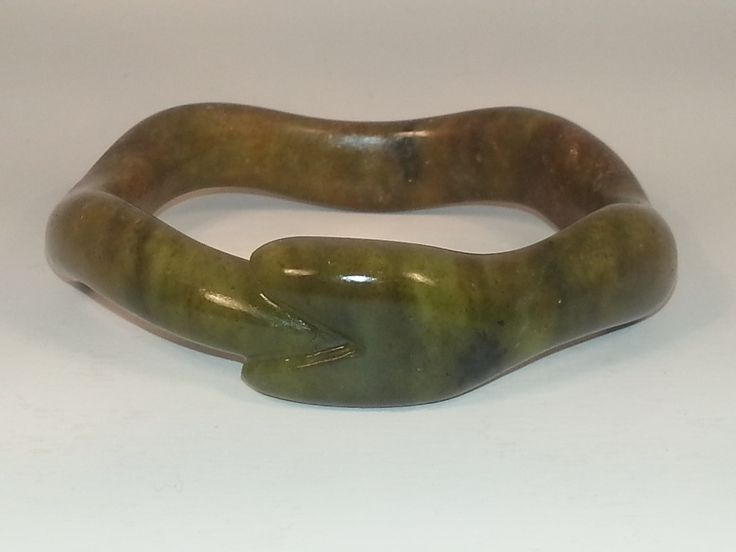 Custom designed and hand carved soapstone bracelet.  One of a kind art piece for a personal fashion statement.  www.artinstones.com