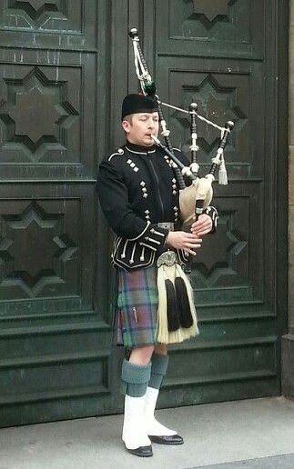 Edinburgh Scotland -- there are bagpipers, @Sarah Abercrombie. Men in kilts!