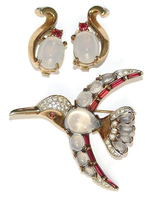 The hummingbird is marked TRIFARI and PAT. Pend.  The earrings are marked TRIFARI with the crown. The bird's body is a tear drop shaped moonstone.