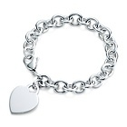 Tiffany & Co. Heart tag charm bracelet. My first Tiffany gift.  The engraving that was put on the heart makes it prettier.