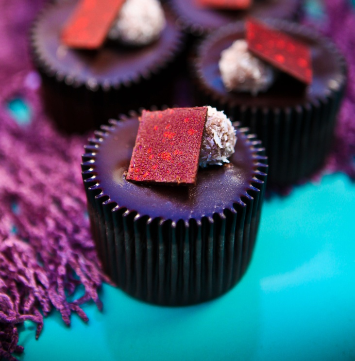 Guilty Pleasure - Delicious Hazelnut Fondant wrapped in moist Dark Chocolate Cake, with a devilishly delicious Chocolate Glaze, Hazelnut & Coconut Truffle and Dark Chocolate Square on top #Ghermez #Cupcakes