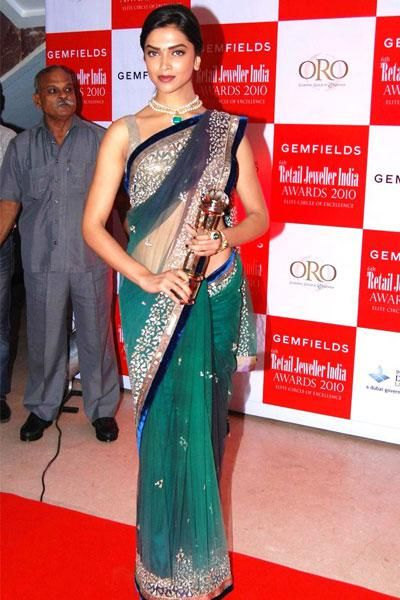 Deepika Padukone in blue and emerald net saree - bollywoodshaadis.com