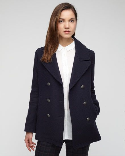Made from a wool mix, this timeless pea coat is great for when the weather cools.  Double breasted, it features metal buttons, full lining and a single back vent.  Other styling details include a contrast under collar. Layer over your smart or casual wardrobe.