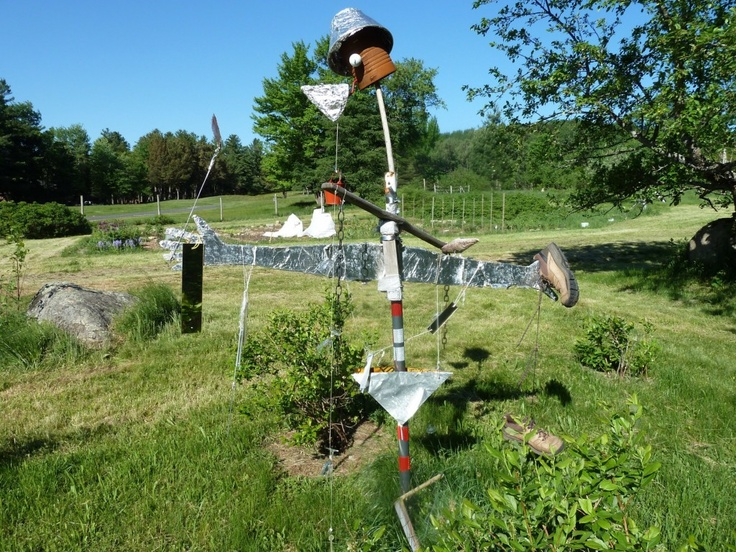 Artist Kristen Jones made this scarecrow for Blue Mountain Center, Blue Mountain Lake. Rather than using old clothes stuffed with hay, she assembled scrap material found on site. Incorporating moving, metallic elements into a scarecrow may improve its efficacy as a bird deterrent. Photo by Jill Breit.