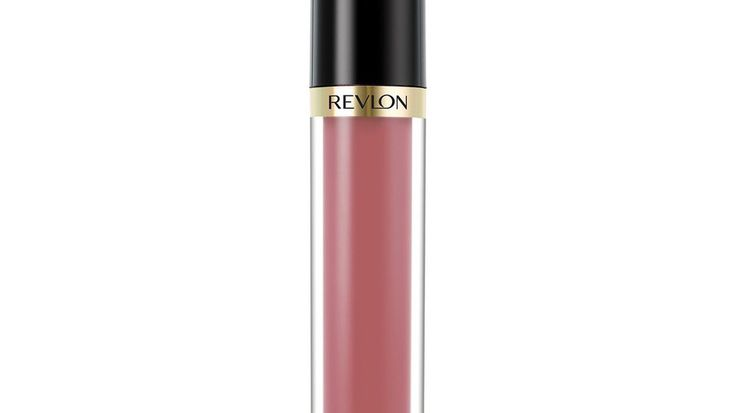 Revlon Super Lustrous Lip Gloss in Super Natural | Did you ever think that the tube of lip gloss you routinely applied throughout your fifth period math class would be a part of your wedding day? There's no shortage of wedding day makeup options for brides. Along with the dress, a soft smoky eye or sharp cat eye can help a bride show off their personal style. However, picking the right lipstick color can be a struggle. There's so many shades and finishes to consider, plus how…