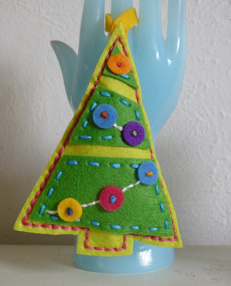 Hand Stitched Bright Buttons Christmas Tree Felt Christmas Ornament. $9.00, via Etsy.