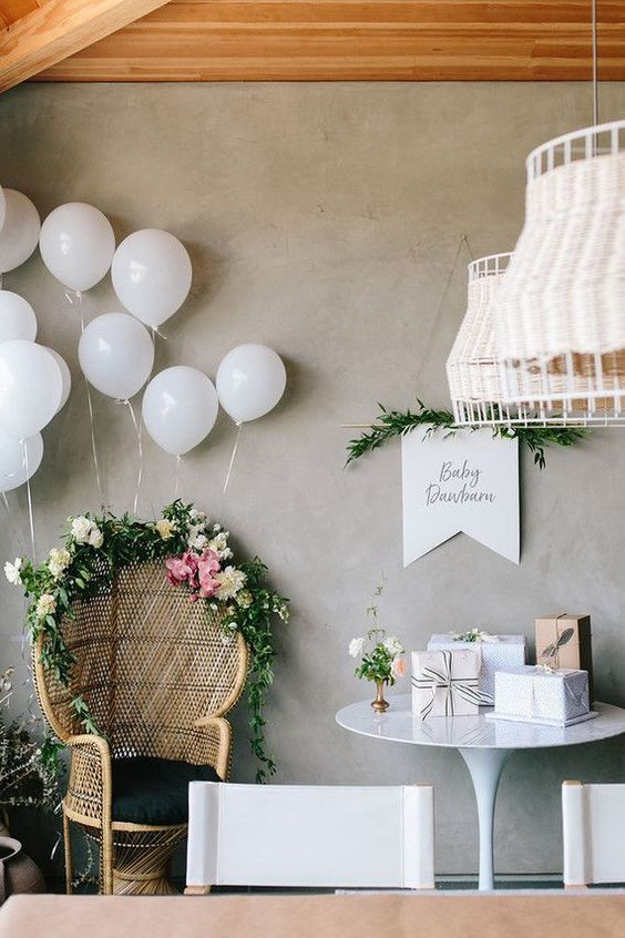 Boho mama-to-be seating area. Modern boho baby shower decor ideas. Balloons, flo…