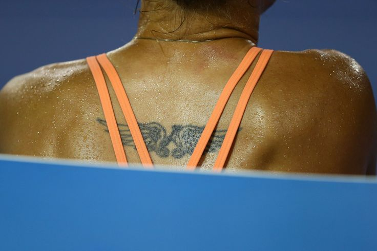 A detailed view of the tattoo on Kateryna Bondarenko of Ukraine's back in her third round match against Belinda Bencic of Switzerland during day five of the 2016 Australian Open at Melbourne Park on January 22, 2016 in Melbourne, Australia. (Source: Ryan Pierse/Getty Images AsiaPac)