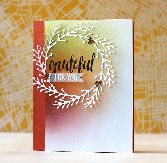 For the background I blended in Mustard, Rust and Deep Burgundy using the ink cubes included in the kit and then adhered a white wreath die cut. I popped up the wreath panel on a piece of Sunset Orange cardstock that is also included in the kit.