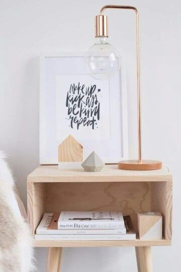 I love the light wood nightstand. It's bright and modern but still cosy.