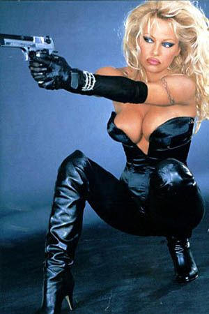 Pamela Anderson in Leather Corset, Gloves & Knee High Heeled Boots