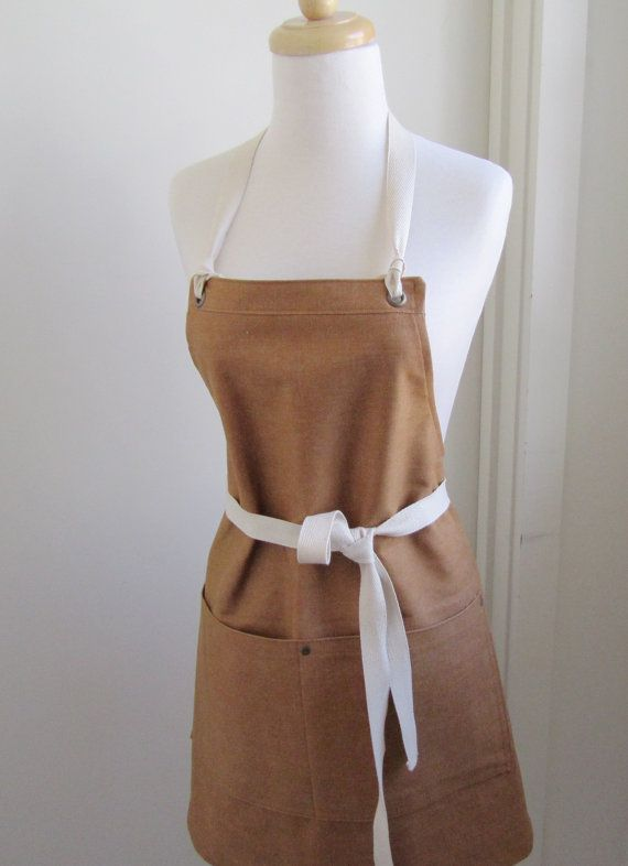 This light brown/ginger colored apron is made from denim by the Kaihara Mill in Japan. The denim is medium weight , not a heavy jean weight. It