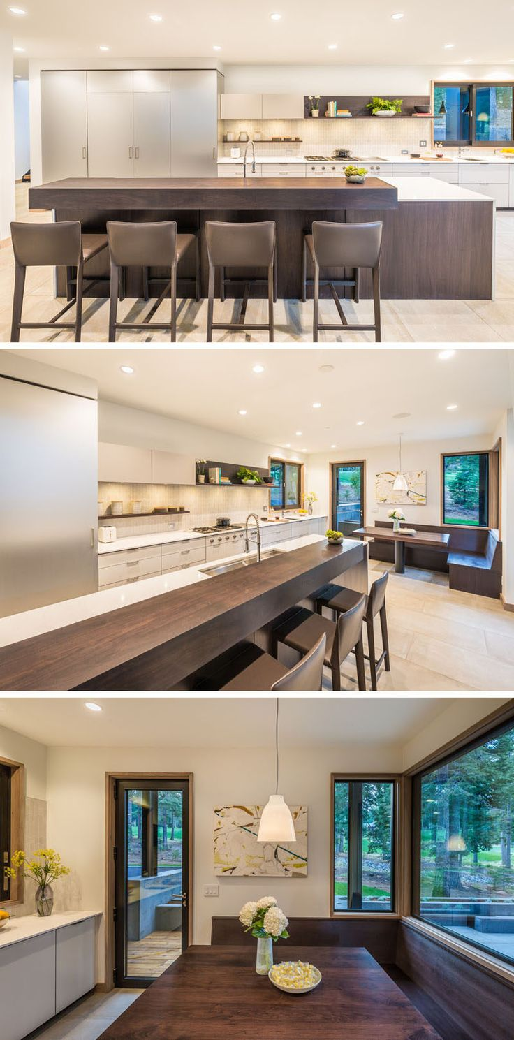 In this modern kitchen, a dark wooden island with bar has been paired with light colored cabinets and countertops. There's also an eat-in breakfast nook in the corner.