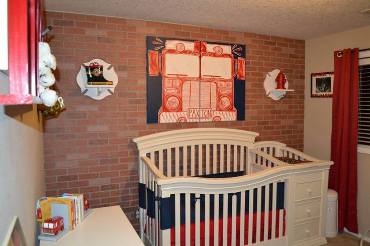 """Firefighter Nursery (1) -Faux brick wall from local hardware store -Firetruck painting by sincerelyYOU on Etsy -Maltese cross shelves and red ladder made by my husband -Fire boots, Dalmation puppy, Fire coat, red curtains/bedding & navy mesh crib liner by Amazon -Picture frame with ultrasound says """"Rookie in the Making""""(supplies from local craft store) -Maltese cross with name by GOalphabetsoup on Etsy -Firetruck bookends found at local store -Light switch cover by HigginsCraftCorner on Etsy"""
