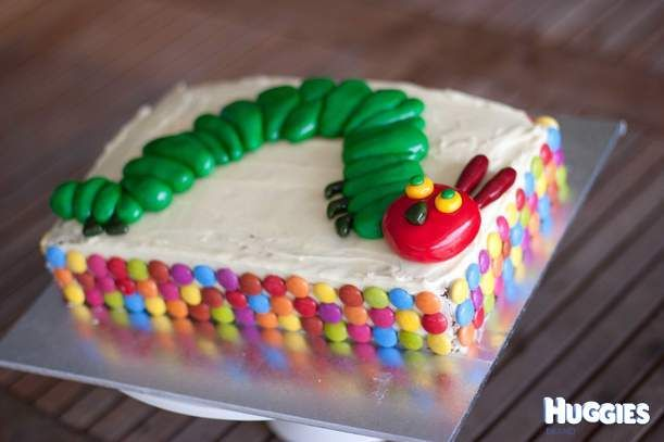 carrot cake with cream cheese icing, caterpillar decoration and smarties.