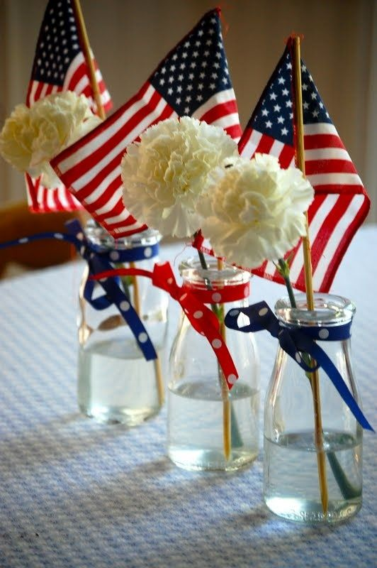 July 4 decor - little flags and fresh flowers in simple glass jars decorated with ribbon